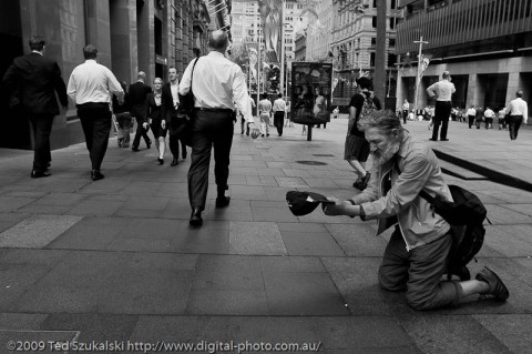 Man begging on his knees